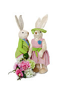 Female and male Rabbits with flower bouquet standing over white background