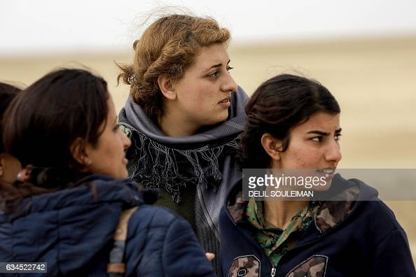 Female Arab fighters among the Syrian Democratic Forces made up of USbacked Kurdish and Arab fighters stand together near the village of alTorshan 20...