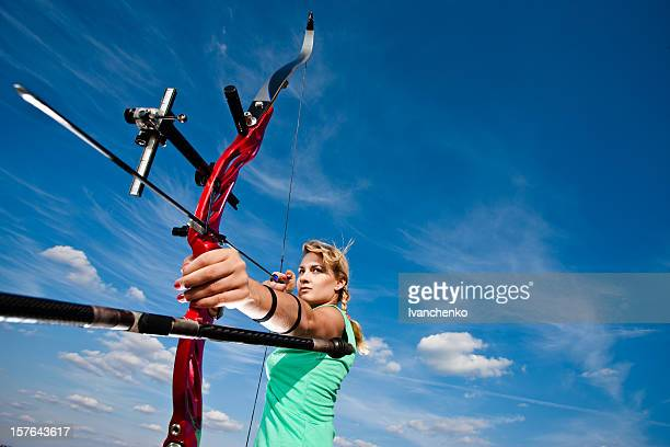 A female archer getting ready to release the arrow