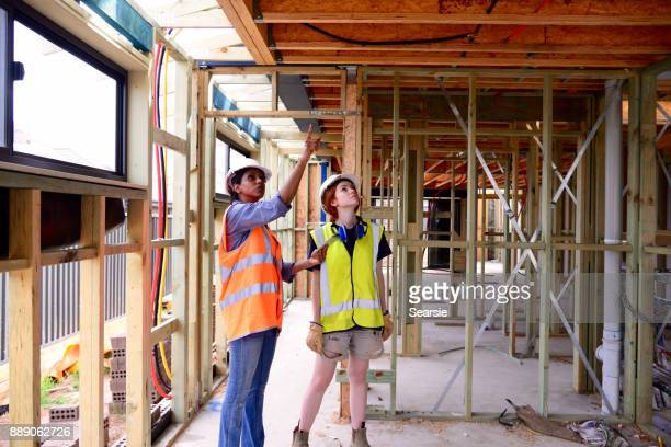 SYD112017 Female Architect and Construction worker using technology
