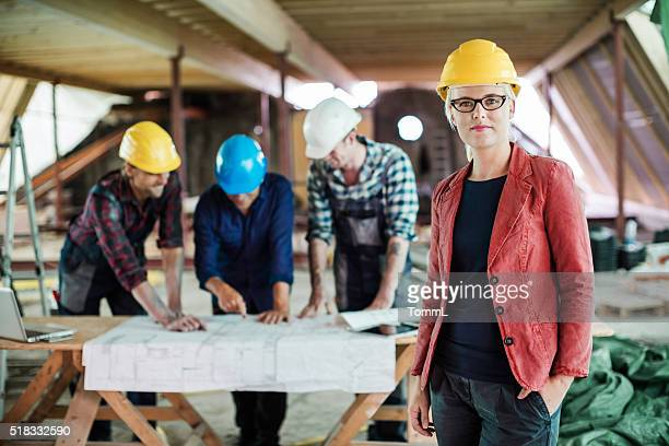 Female Architect And Construction Workers