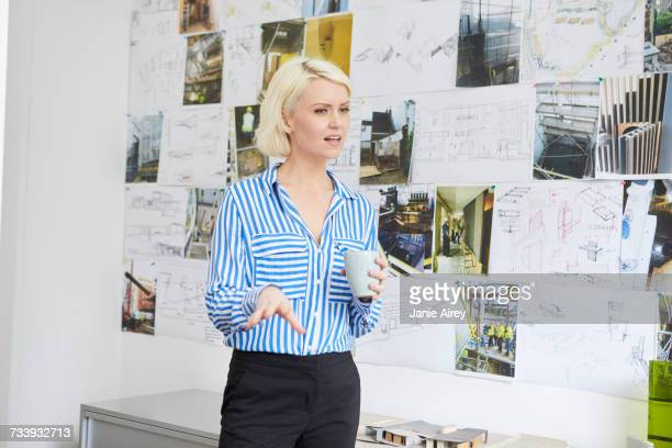 Female architect explaining mood board in office presentation