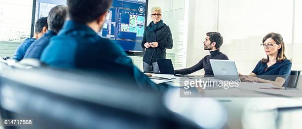 Female architect having a presentation
