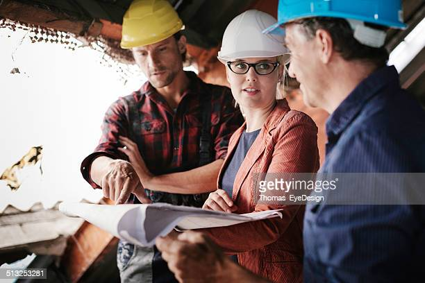 Female Architect Meeting with Construction Workers