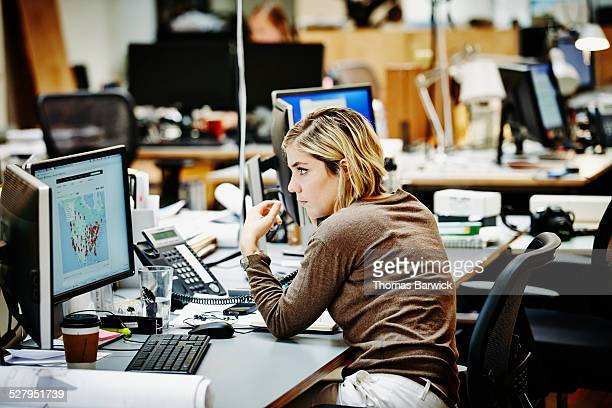 Female architect on the phone with client