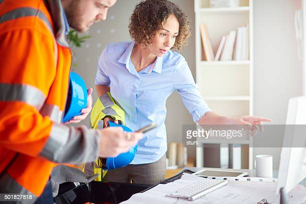 female architect with foreman