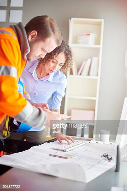 female architect with site foreman