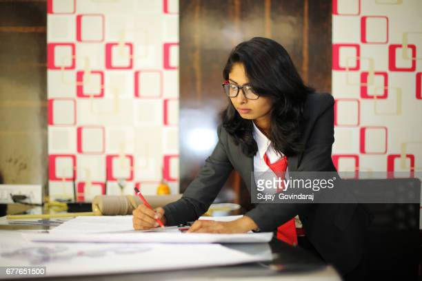 Female Architect Working in Office