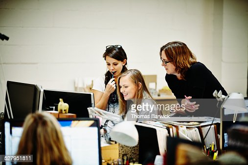 Female architects reviewing project on computer