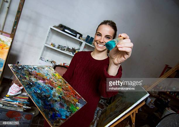 Female artist in her studio
