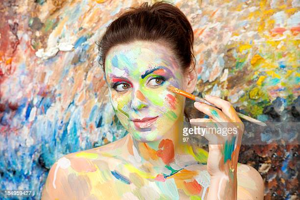 Female artist painting herself