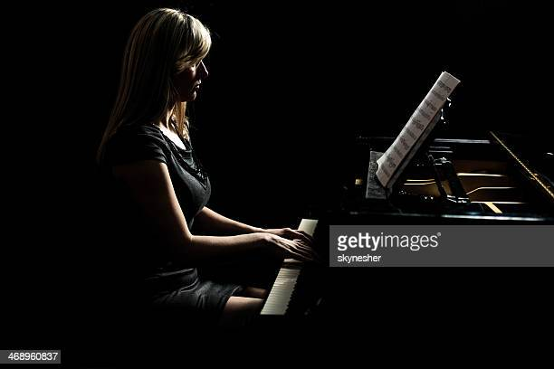 Female artist playing the piano.