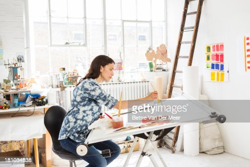 female artist working in studio.