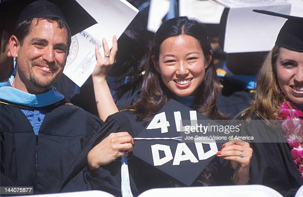 Female AsianAmerican UCLA graduate with For you Dad cap Los Angeles CA