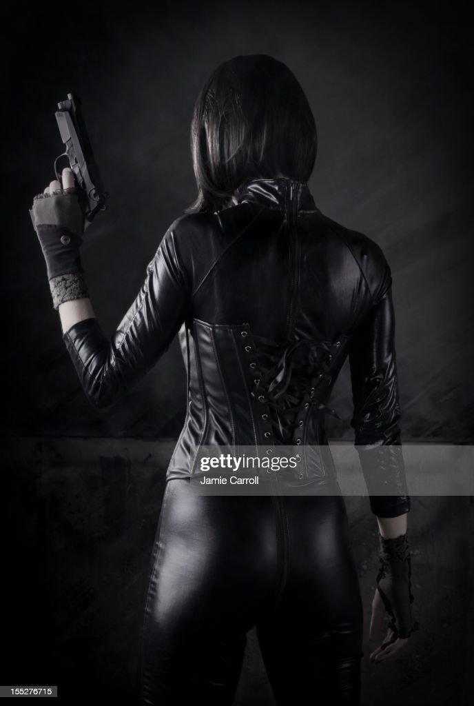 Female Assassin with gun : Stock Photo