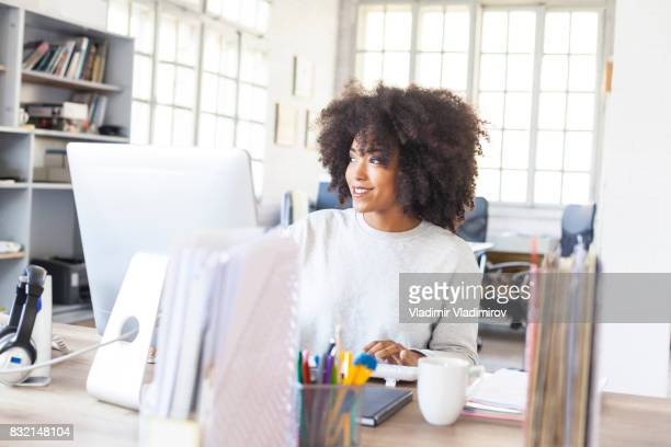Female assistant working in modern office