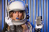 Female Astronaut holding Am transistor Radio