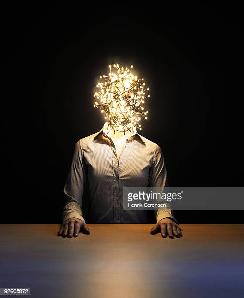 Female at desk with fairy light wrapped head