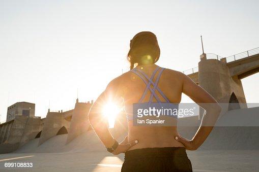 'Female athlete at sunset, Van Nuys, California, USA'