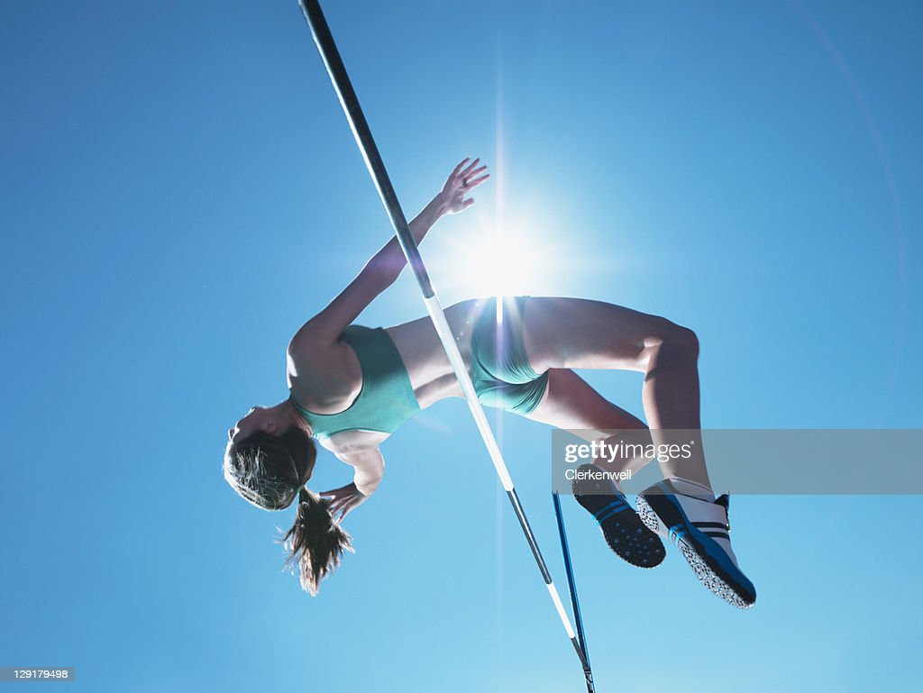 Female athlete clearing high jump : Stock Photo