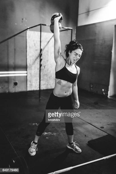 Female Athlete doing Dumbbell exercise