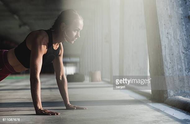 Female Athlete Doing Planks