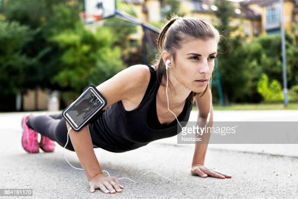 Female Athlete Doing Planks