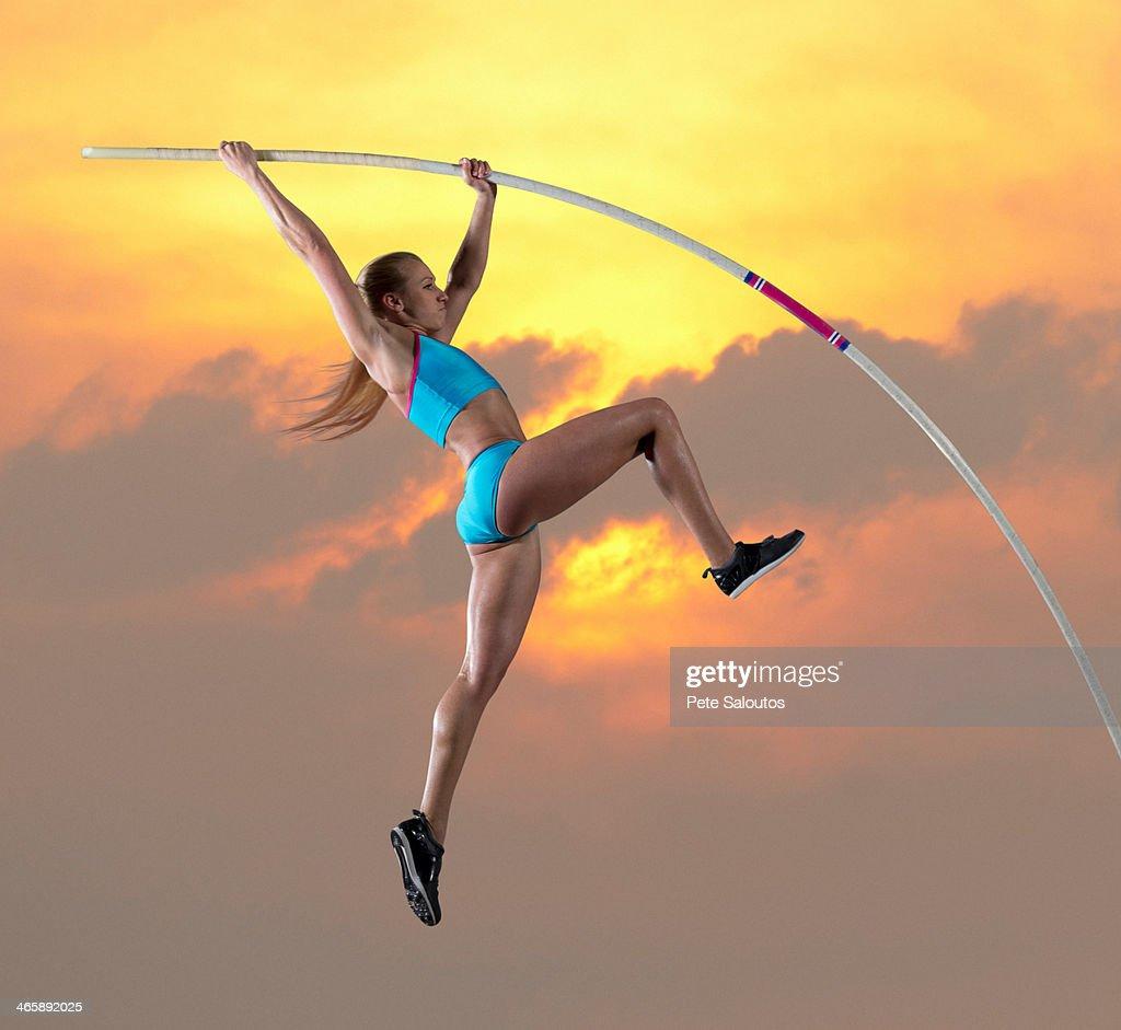 Female athlete doing pole vault