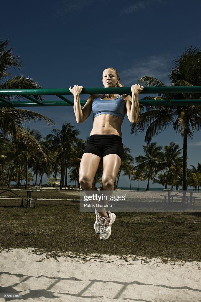 Female athlete doing workout on the beach. : Stock Photo