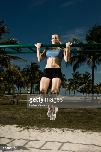 Female athlete doing workout on the beach. : Stock Photo