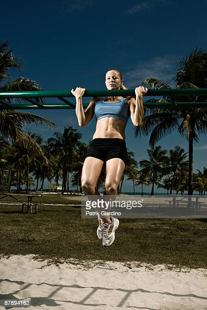 Female athlete doing workout on the beach.