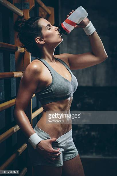 Female athlete drinking