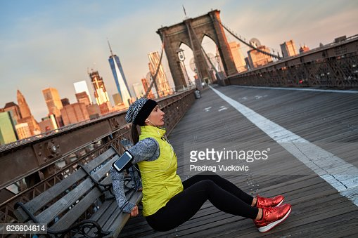 Female athlete exercising on the bridge