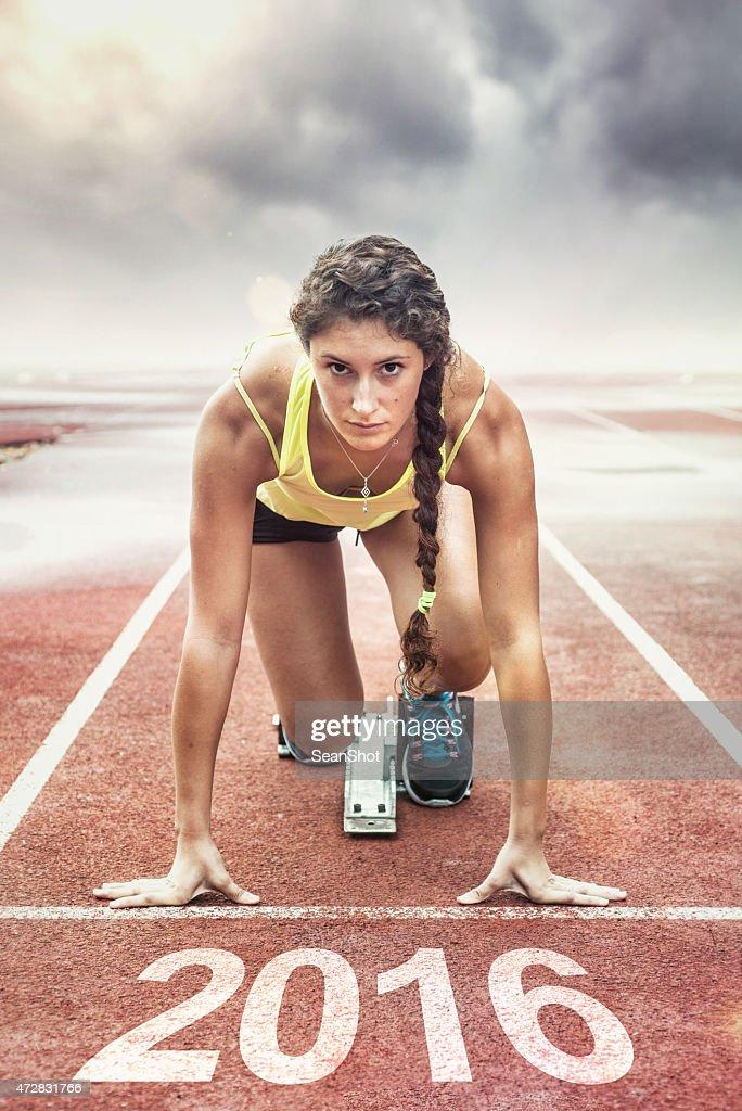 Female athlete in the starting blocks