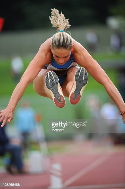 Female athlete in third phase of triple jump