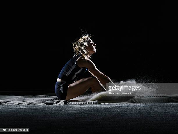 Female athlete landing in long jump