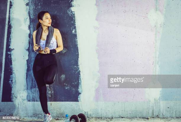 Female Athlete Leaning on Wall