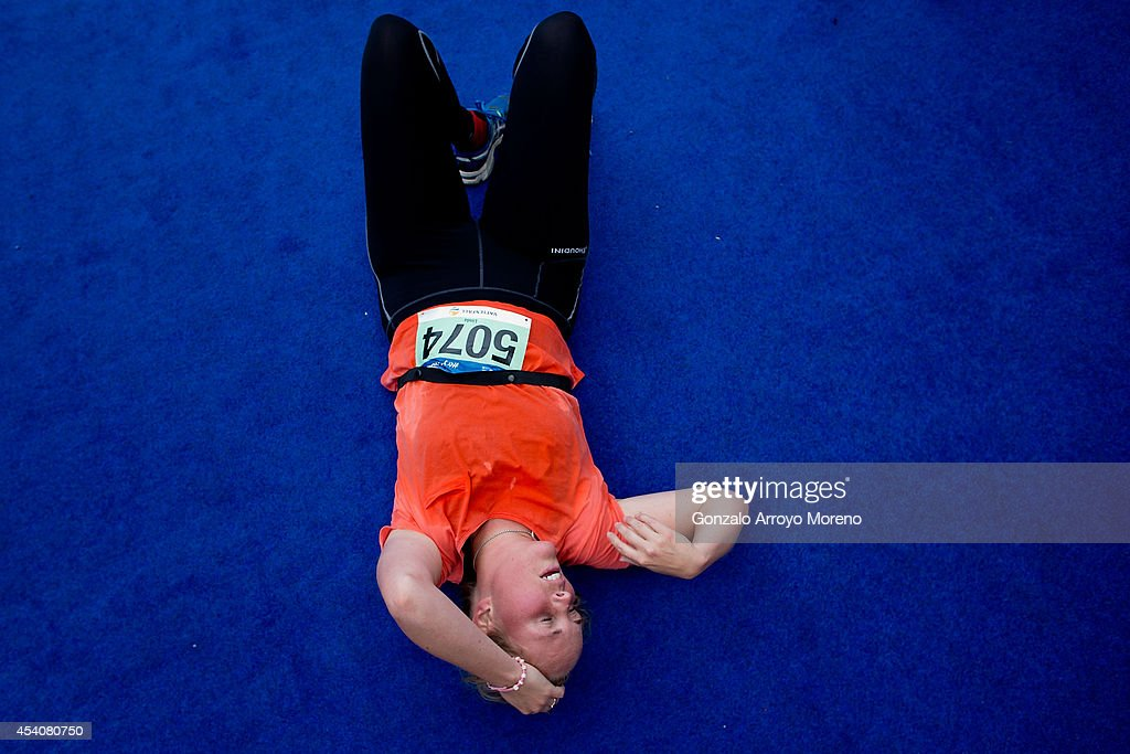 A female athlete lies on the ground exhausted after finishing the Team Relay Race during the ITU World Trathlon on August 24, 2014 in Stockholm, Sweden.