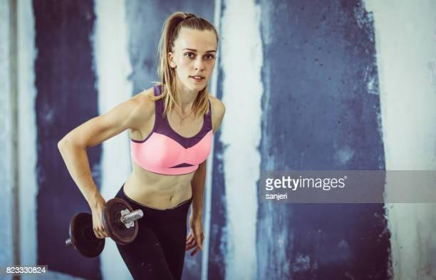 Female Athlete Lifting Fitness Weights