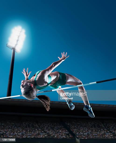 Female athlete performing high jump