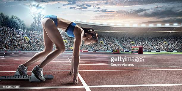 Female athlete prepares to run