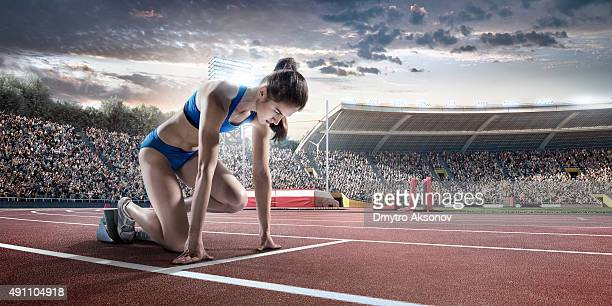 Female athlete prepares to run