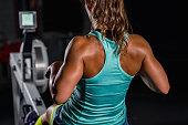 Female athlete, rowing machine exercising