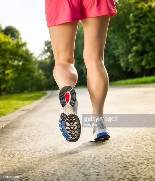 Female athlete running - perfect legs