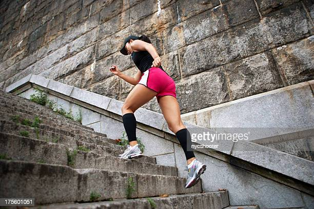 female athlete running stairs