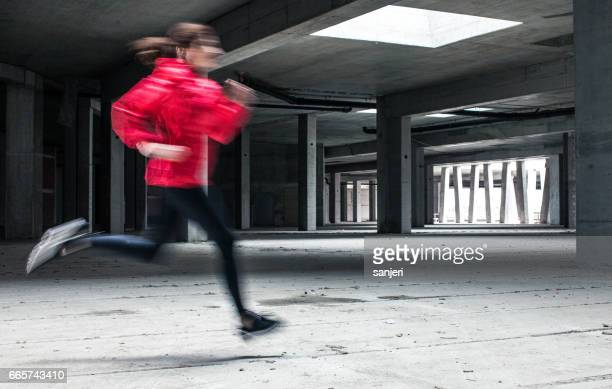 Female Athlete Running Through a Abandoned Building