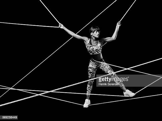 Female athlete standing on ropes