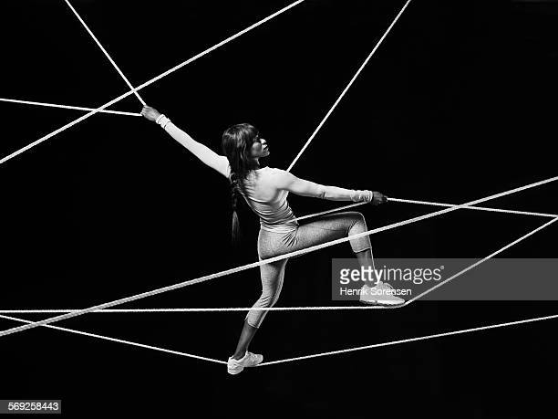 Female athlete stretch out on ropes