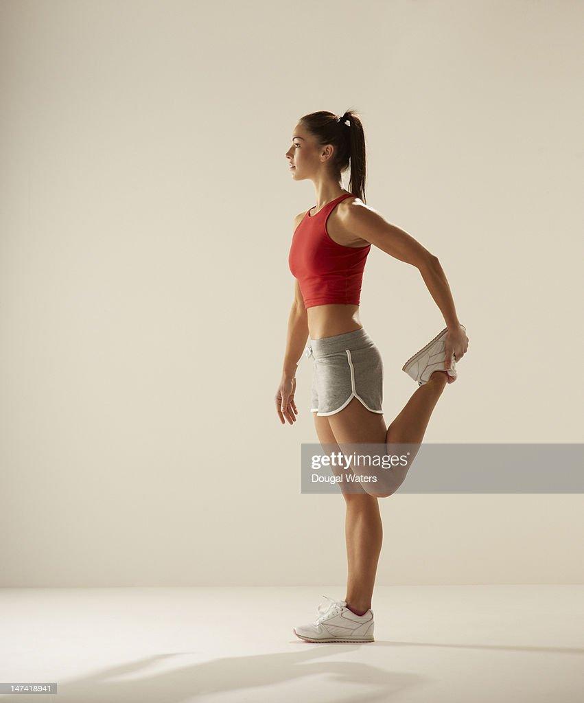 Female athlete stretching. : Stock Photo