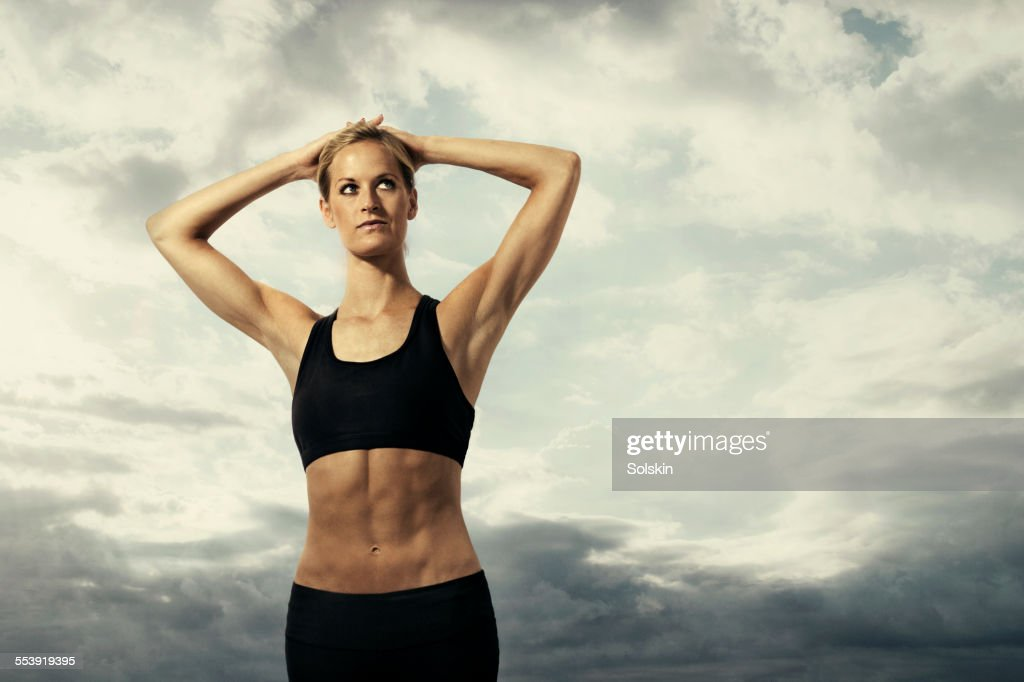 Female athlete stretching : Stock Photo